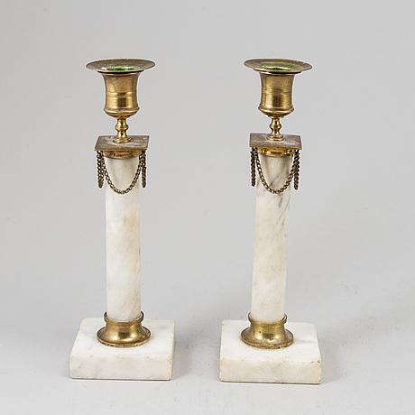 A pair of late gustavian candlesticks, circa 1800.