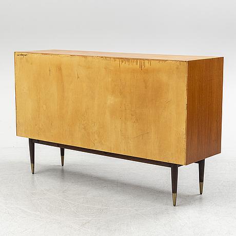 A second half of the 20th century teak av rosewood veneered sideboard.