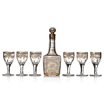 355. A set of six Russian glass goblets and a bottle with stopper, 19th Century.