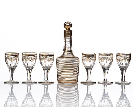 A set of six russian glass goblets and a bottle with stopper, 19th century.