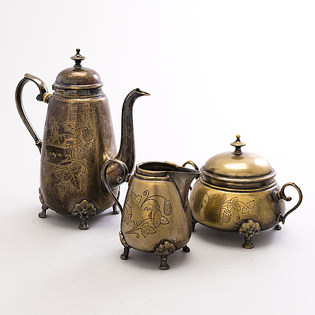 A coffee set including a caffee pot, cream jug and sugar bowl, gilded epns, plewkiewicz, warsaw, around 1900.
