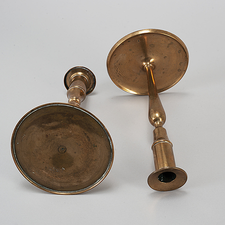 A pair of brass candlesticks, early 19th century.