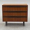 A mid 20th century teak veneered chest of three drawers.