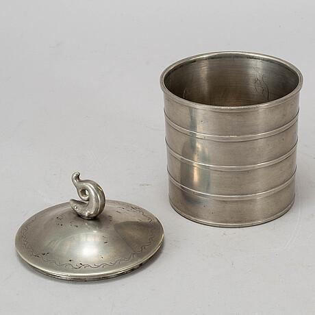 A lidded pewter jar from svenskt tenn, stokholm, 1929.