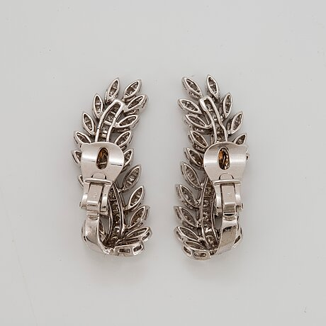 A pair of 18k white gold earrings set with round brilliant-cut diamonds.