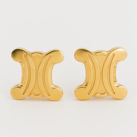 A pair of celine earrings.