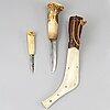 A double sami reindeer horn knife, dated 1923.