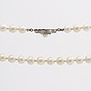 Peral necklace cultured pearls approx 8 mm, clasp 18k whitegold w 1 cultured pearl approx 5,5 mm and single-cut diamonds.
