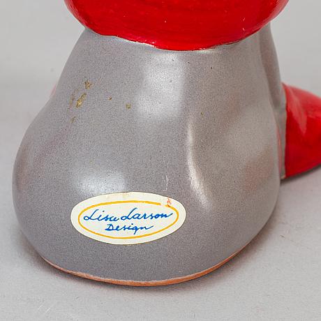 Lisa larson, a set of seven earthenware candlesticks.