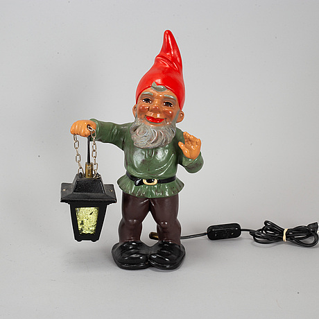 A heissner ceramic gnome with lamp.