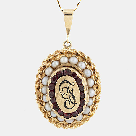 Gold locket with faceted garnets and pearl, with gold chain.