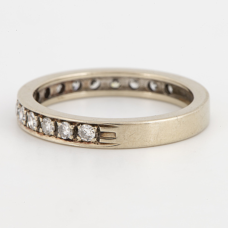 Half-eternity white gold with eight-cut diamond ring.