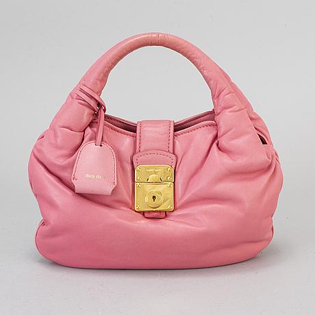 Miu miu, a pink leather bag.