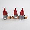Lisa larson, a set of three candle sticks.