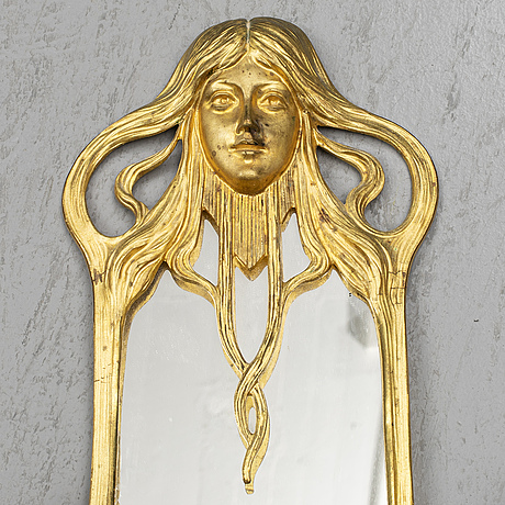 A pair of art nouveau mirror wall sconces, easly 20th century.