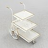 A white lacquered metal and brass serving trolley, 1940's-50's.