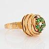 An 18k gold wa bolin ring set with demantoid garnets and round brilliant-cut diamonds.