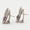 18k white gold and faceted ruby earrings.