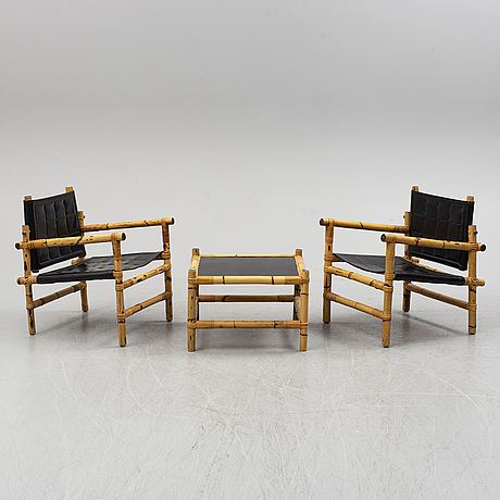 A pair of armchairs and table, second half of the 20th century.