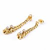 A pair of gold earrings with diamonds ca 0.16 ct in total.