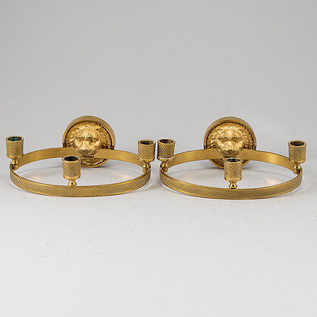 A pair of empire-style three-light wall-lights, beginning of the 20th ct.
