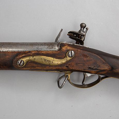 A flintlock shotgun, circa 1800.