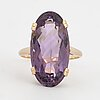 An oval faceted amethyst cocktail ring.