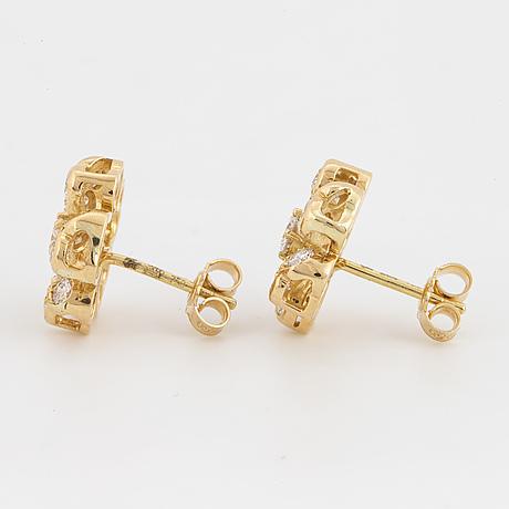 Brilliant-cut diamond flower earrings.