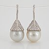 A pair of cultured south sea pearl and diamond earrings.