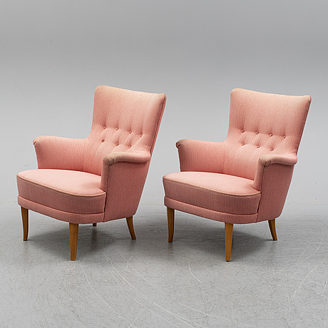 A pair of carl malmsten easy chairs.