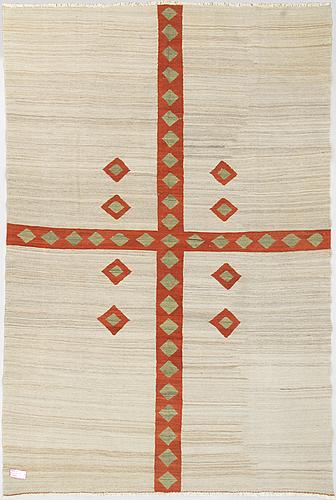 A flatweave rug, 295 x 199 cm.
