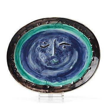"""144. Pablo Picasso, a faience dish """"Visage dans un ovale"""", Madoura, Vallauris, France post 1955, A Ramié 273."""