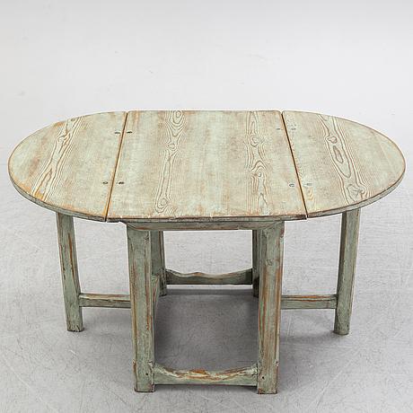 An 18th century gate leg table.