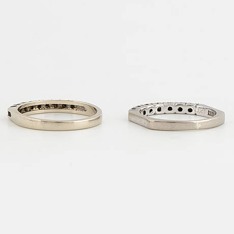 Two half eterinity rings with brilliant-cut diamonds.