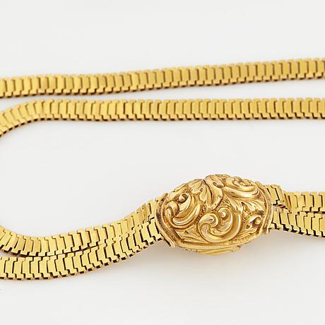 Long watch chain.