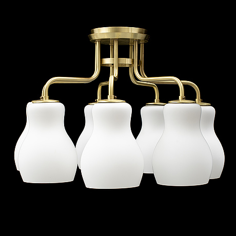 A swedish modern brass and glass ceiling light.