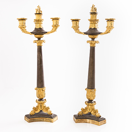 A pair of late empire bronze candelabra, first half of 19th century.