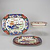 A part earthenware 'chinoisoire' dinner service, 20th century (39 pc).