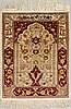 A rug, old silk hereke, ca 74,5 x 51 cm.