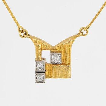 A Björn Weckström 18K gold necklace with brilliant-cut diamonds.