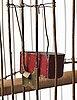 Firma svenskt tenn, a brass coloured metal birdcage, first half of 20th century, provenance estrid ericson.