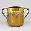 An art nouveau brass champagne cooler, early 20th century.