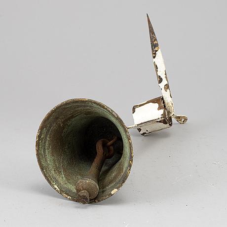 A bronze and iron door bell, 19th century.