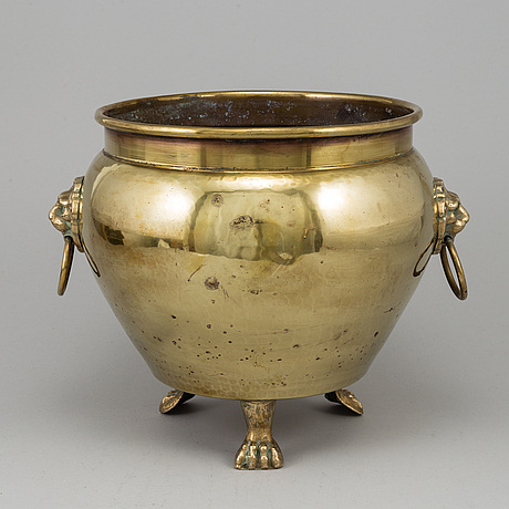A 19th century brass champagne cooler.