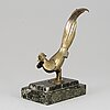 A pair of book ends and a paperpress, bronze and marble, 1930s.