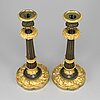A pair of ormolu late empire candlesticks, mid 19th century.