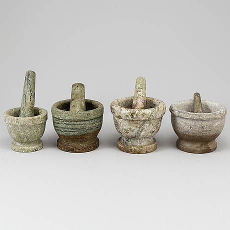 Four swedish green marble mortars and pestles, early 20th century.