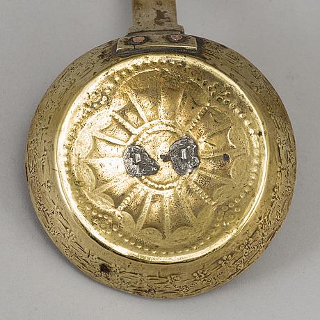 An 18th century brass night light holder.