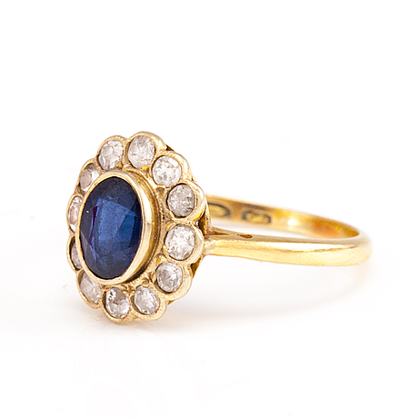 An 18k gold ring with a synthetic sapphire and diamonds. 1928.