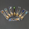Eight a.michelsen sterling silver and gilded with enamel christmas spoons, 1973-1980, ca 380 gram.